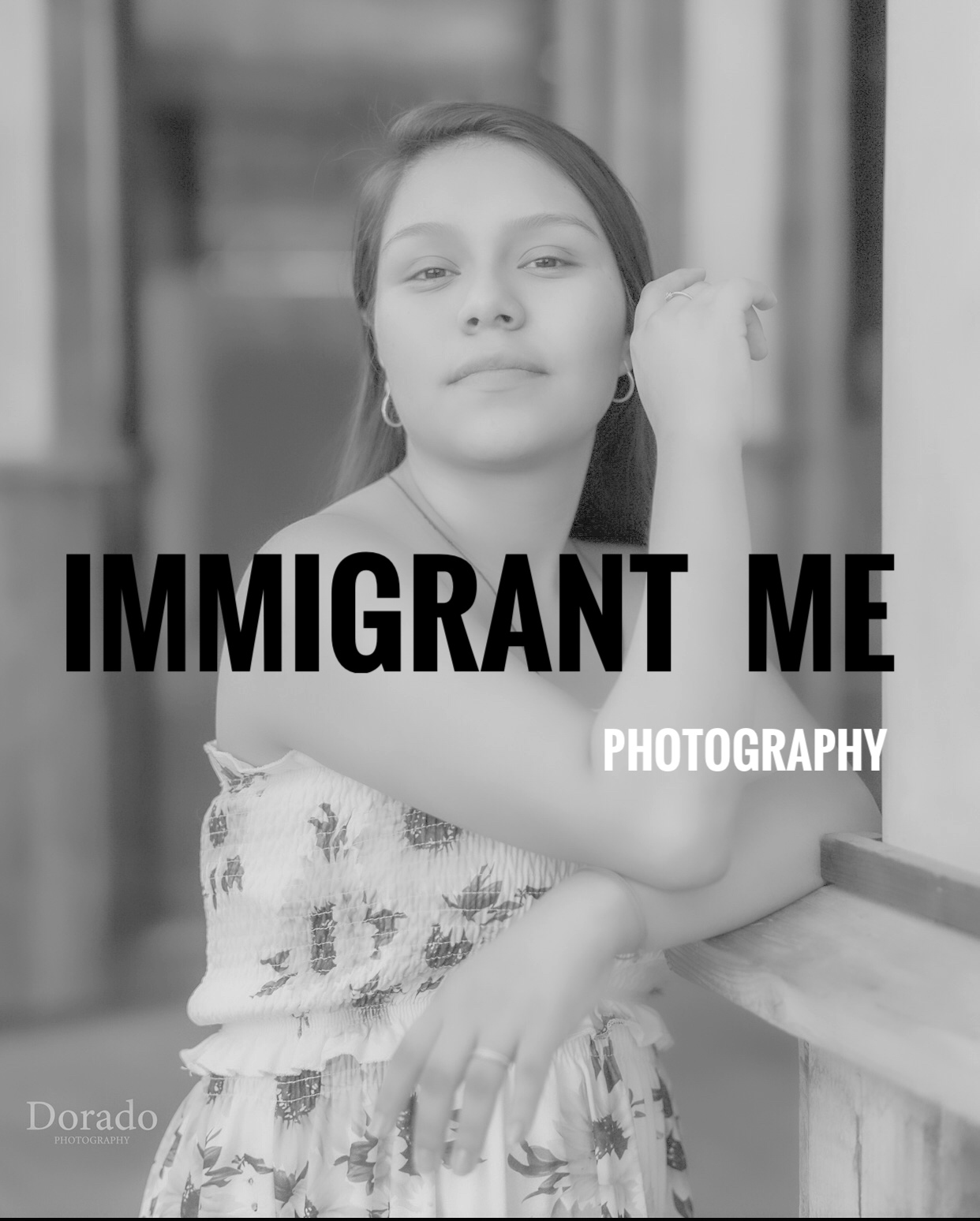 A photo of a woman posed and glancing off in the distance from the immigrant me exhibit