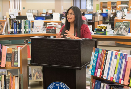 woman speaking in a library