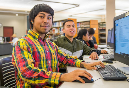 male students at a computer