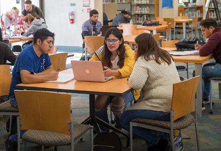 Student gathered around a study table